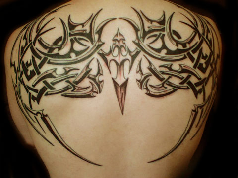 tribal bird tattoo. tribal back tattoo